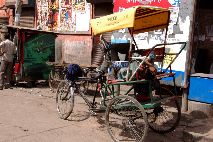 Man sleeping in his rickshaw